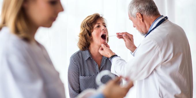 doctor examining throat